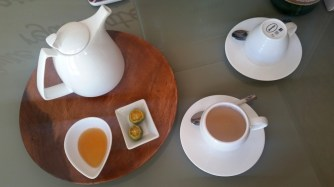 Ginger tea with honey and calamansi
