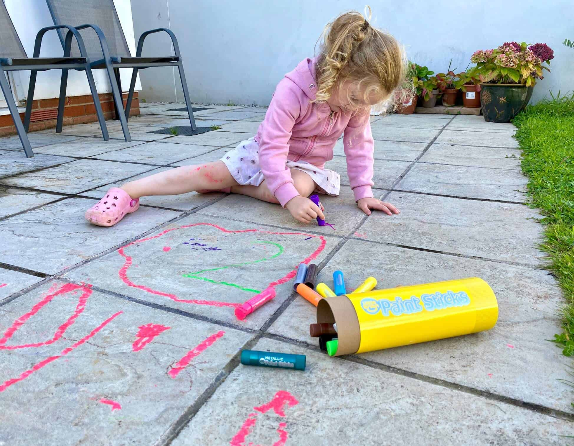 Painting-a-hopscotch-with-the-Little-Brian-Paint-Sticks