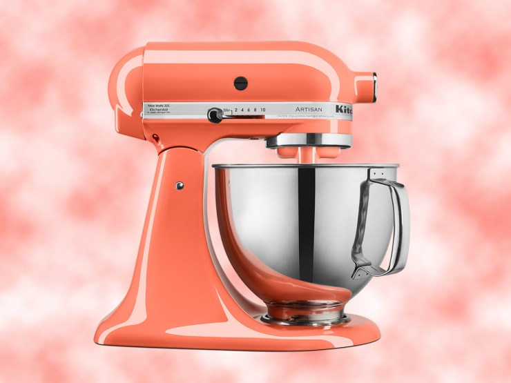 Coral coloured kitchen aid mixer on coral cloud background