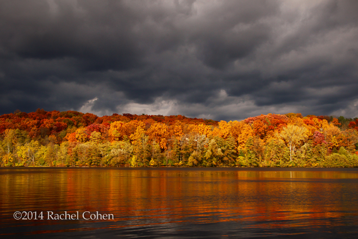 """Fall Storm of Reflections"" The fall color reflected beautifully on the water as the sun and clouds did their battling!!"