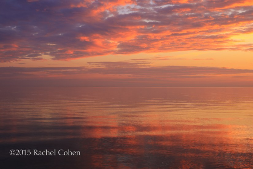 """Spectacular Sunset"" An amazing sunset on glassy waters of Lake Michigan!"