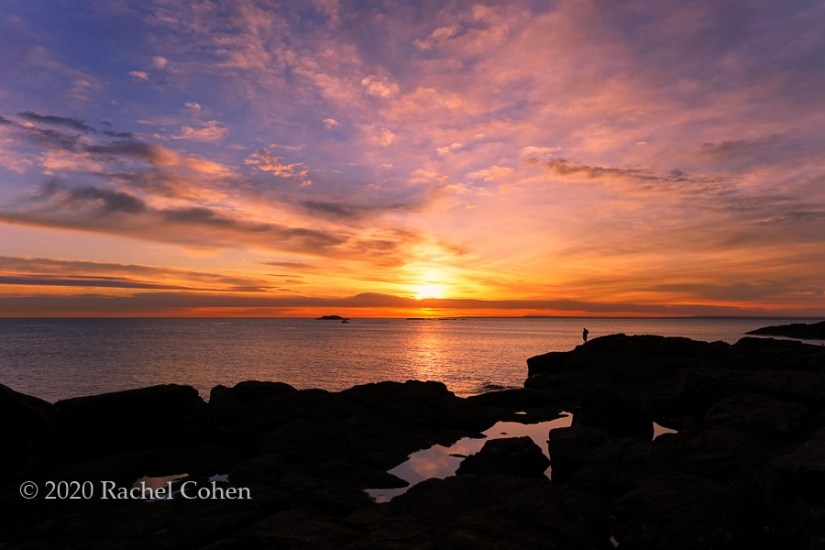 """Sunrise Contemplation 2""  A gorgeous sunrise along the black rocks at Presque Isle in Marquette, Michigan!"
