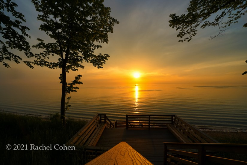 """""""Sun Going Down on Me""""  A beautiful sunset as viewed from the top of the stairs while gazing out at Lake Michigan!"""