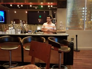 Oscar behind the bar