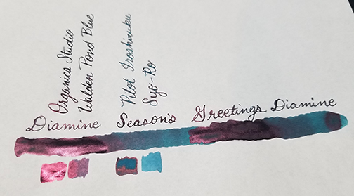 Photograph showing ink sheen for Inkvent Day 16 ink Seasons Greetings