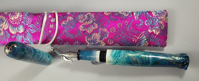 The ARTUS with the pink and blue silk sleeve I bought for it.