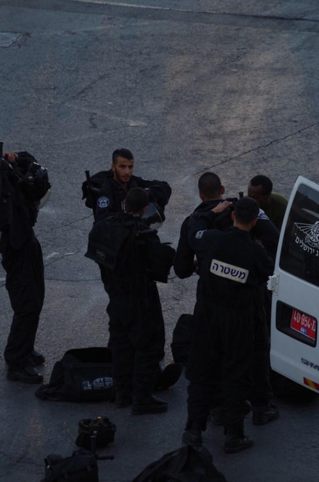 Riot police preparing