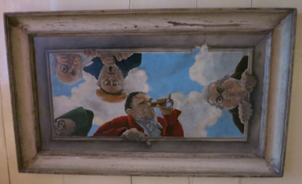 A whimsical painting on the ceiling of the top floor of the Brilmuseum in Amsterdam.