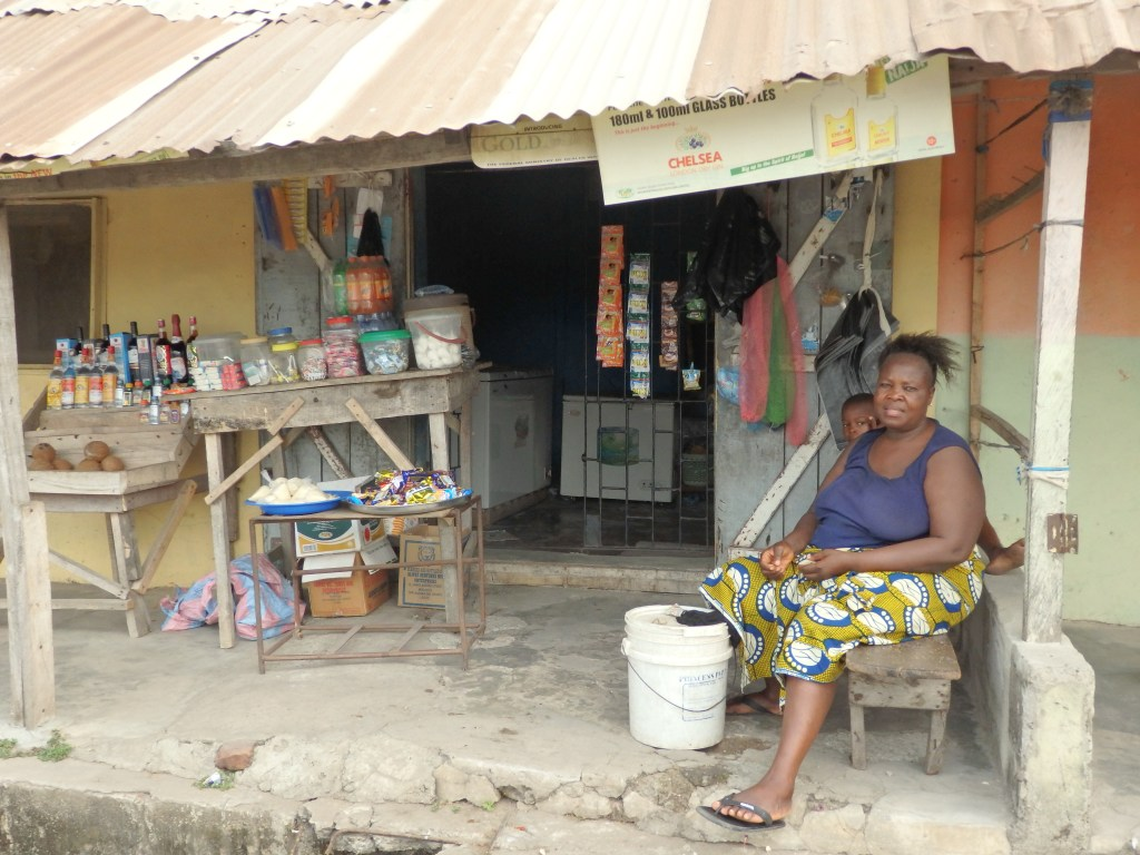A shopkeeper and her shop in Badagry, Lagos, Nigeria
