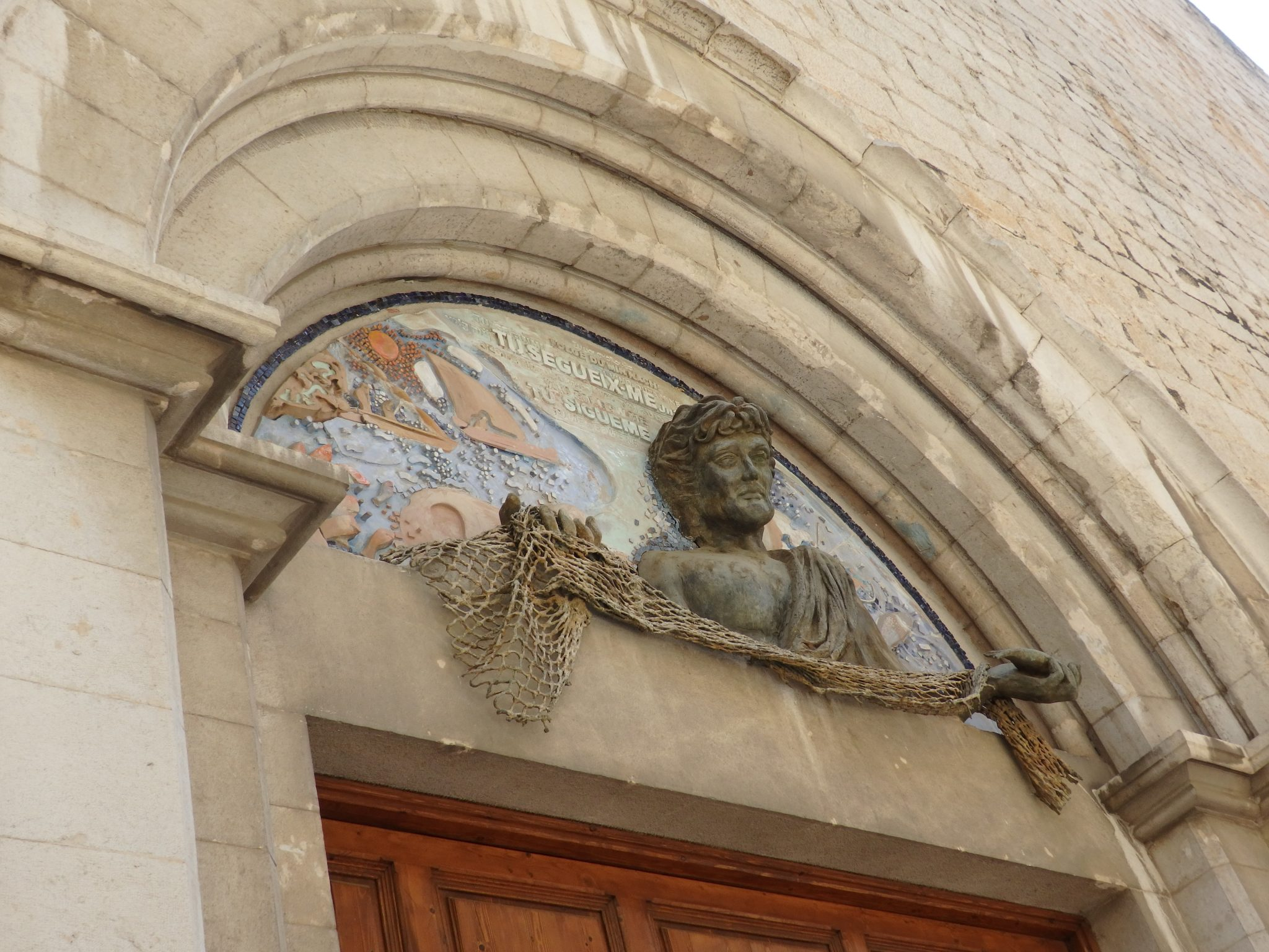 above the entrance to the church of Sant Pere in Figueres, Spain