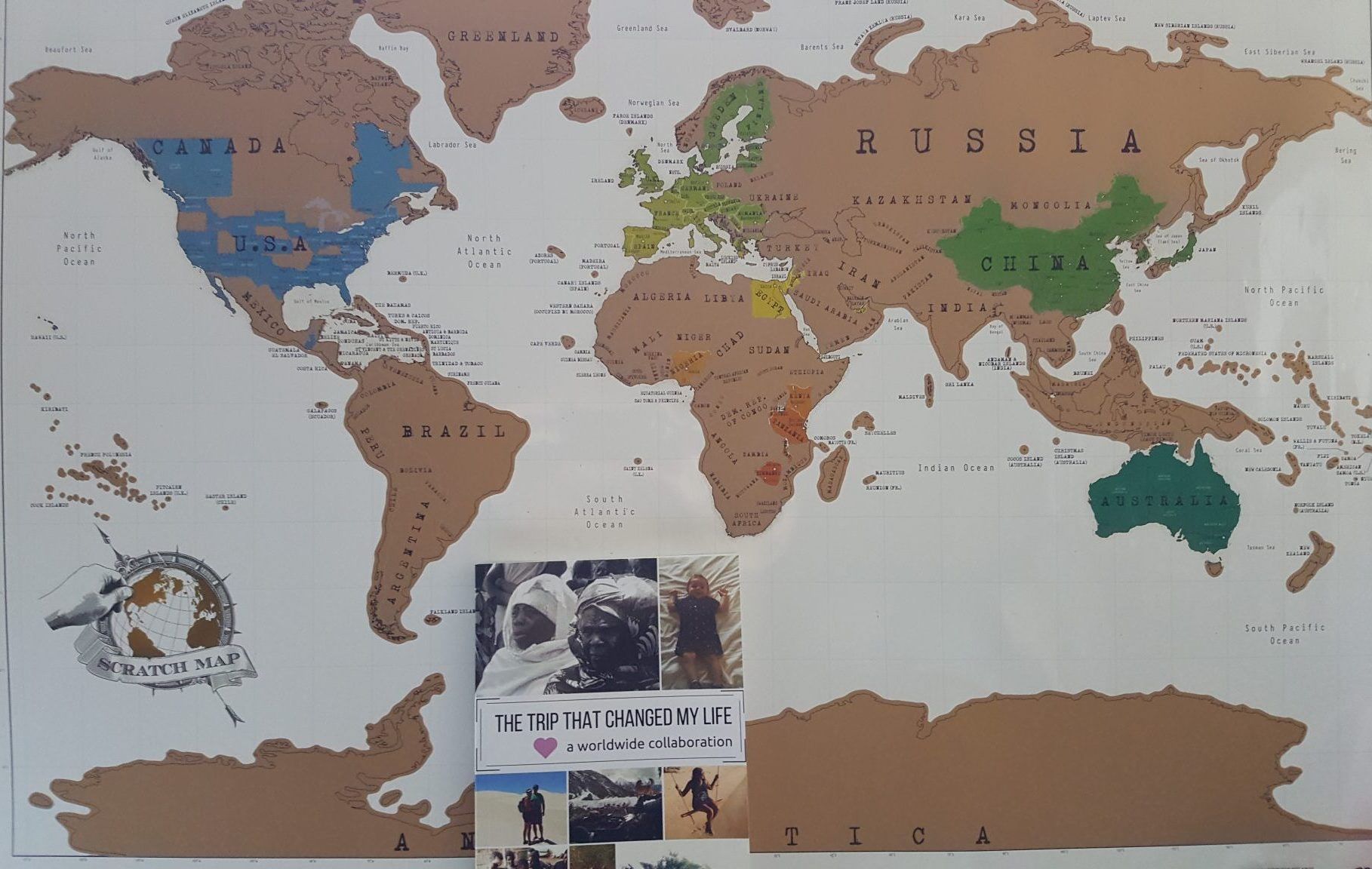 It seems appropriate somehow to pose the book in front of my scratch-off world map. I have so much more traveling to do!