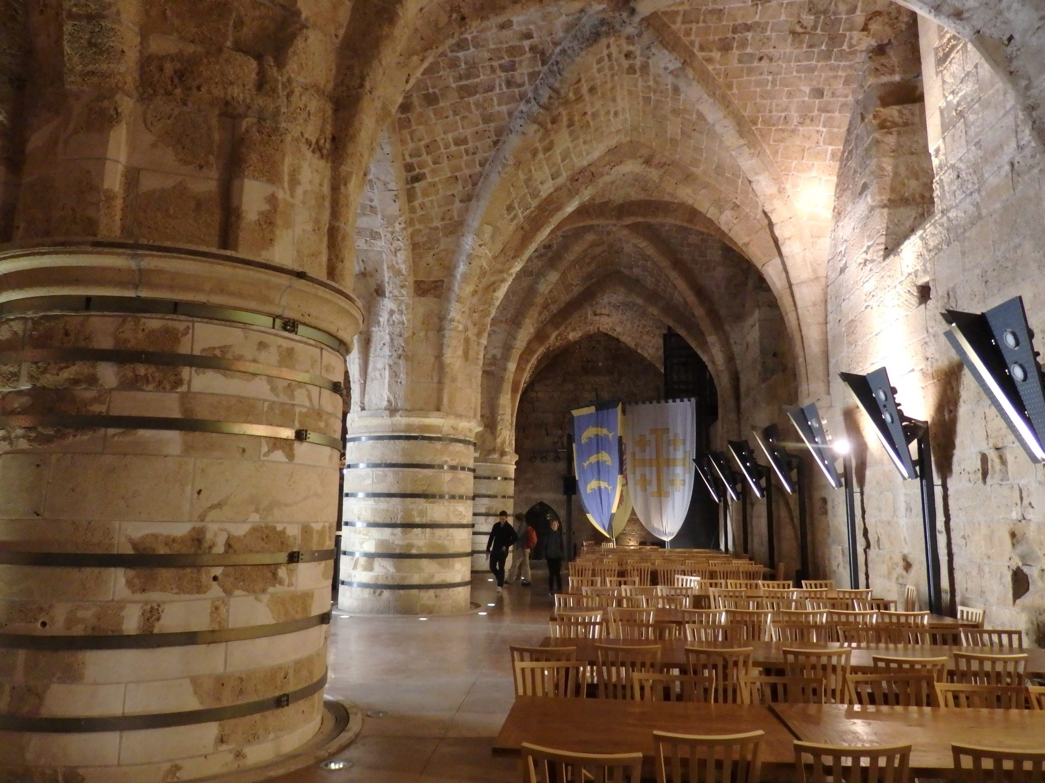 A hall in the Knights Hospitaller's fortress, with massive columns supporting gothic cross arching.