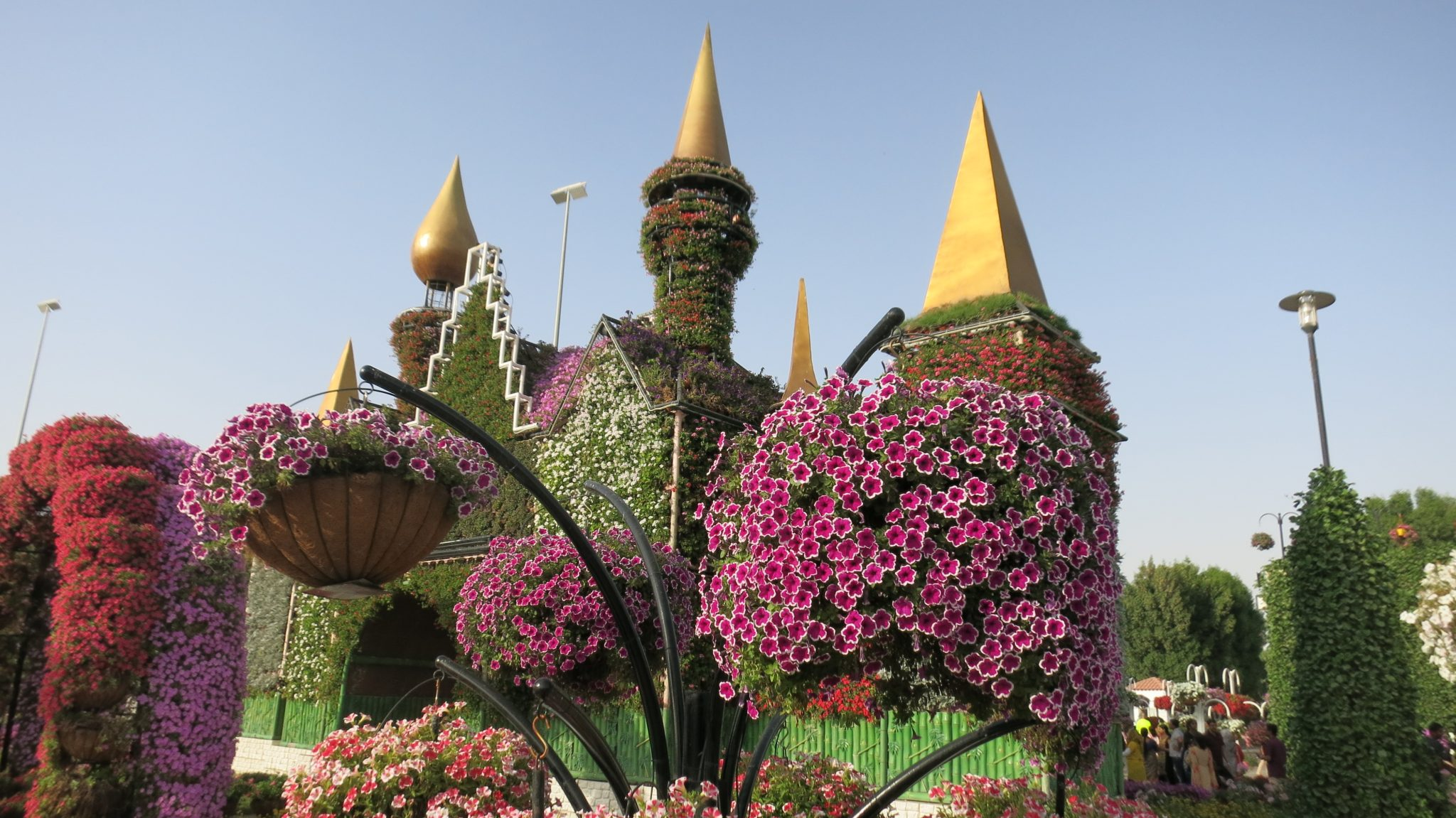 Flowers on the gateway with the mismatched towers at Dubai Miracle Garden