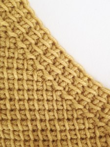 Decrease: 1 Tunisian simple stitch and 1 slip stitch together