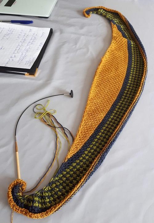 Wip Tunisian crochet crescent shawl with Triskelion yarn