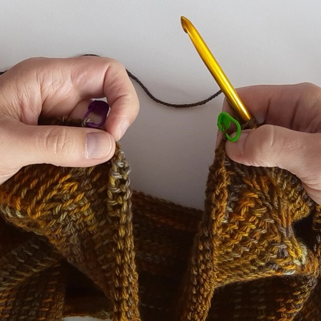 Add stitches to shape the underarm of a top down sweater in Tunisian crochet