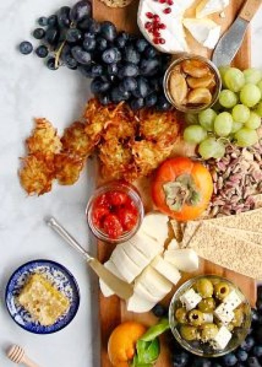 Latke Cheese Board with Garlic and Tomato Confit