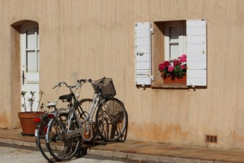 Tiny houses boast colourful flower baskets and old fashioned bicycles