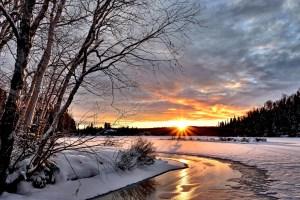 sunset over a snowy scene