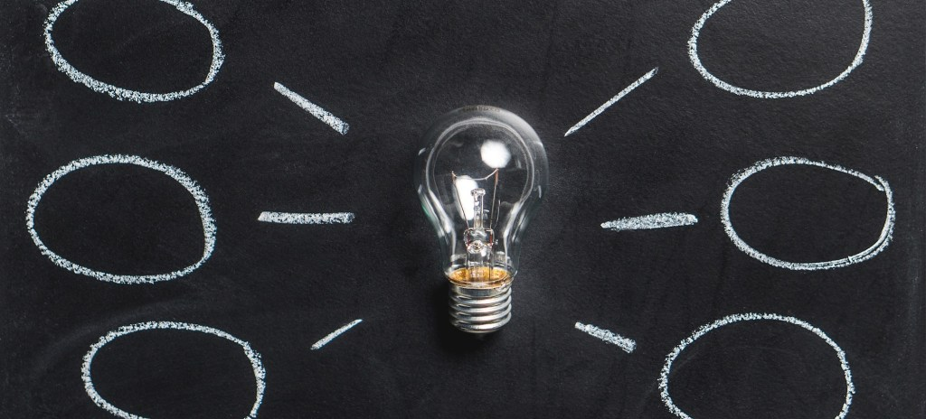 lightbulb with a blackboard and thought bubbles