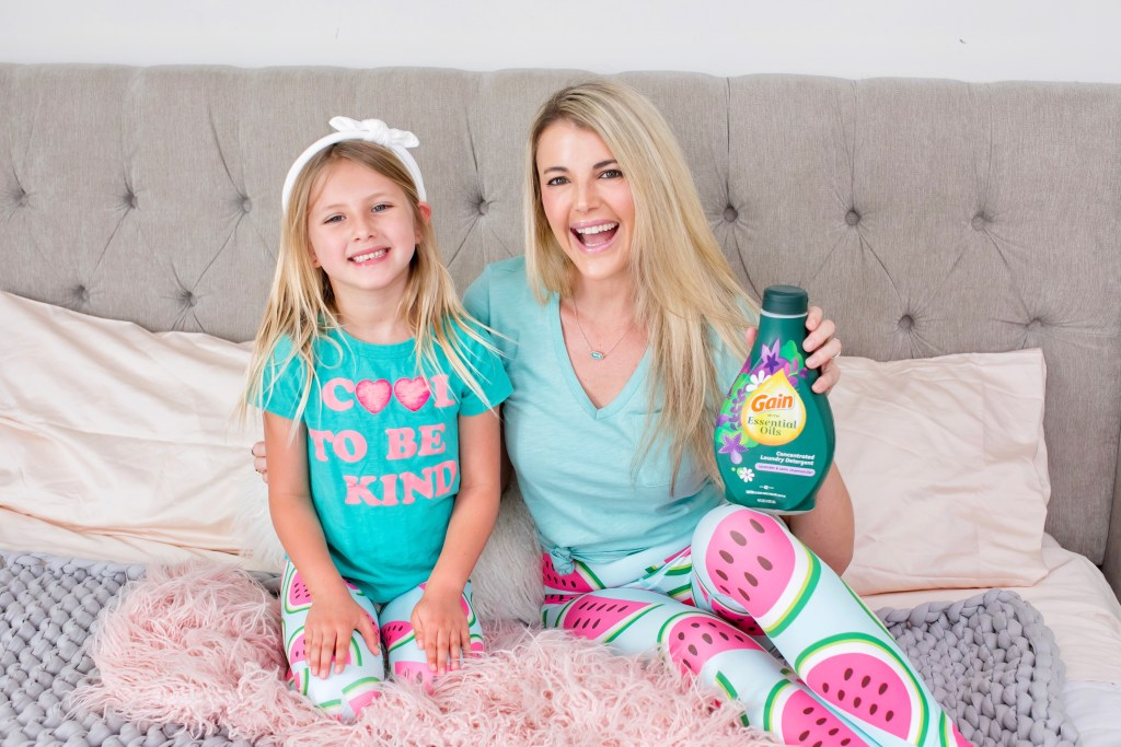 Mother and daughter holding Laundry Detergent