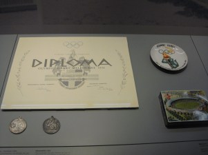 The certificate and medals form the 1956 Melbourne Olympics