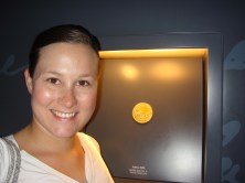 Standing in front of a gold medal from the 2000 Sydney Olympics