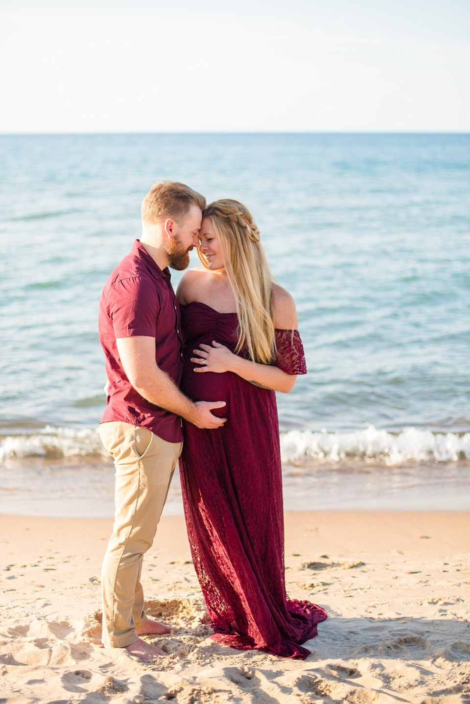 maternity portrait of husband and wife in front of lake michigan