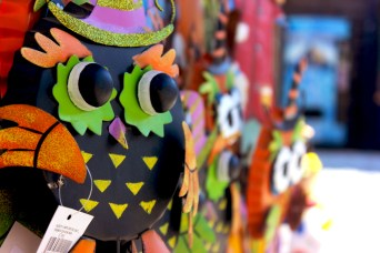 Metal yard decorations are sold at the center shed at Burt's Farm in Dawsonville, Ga. This owl greets customers as they enter the pumpkin patch.
