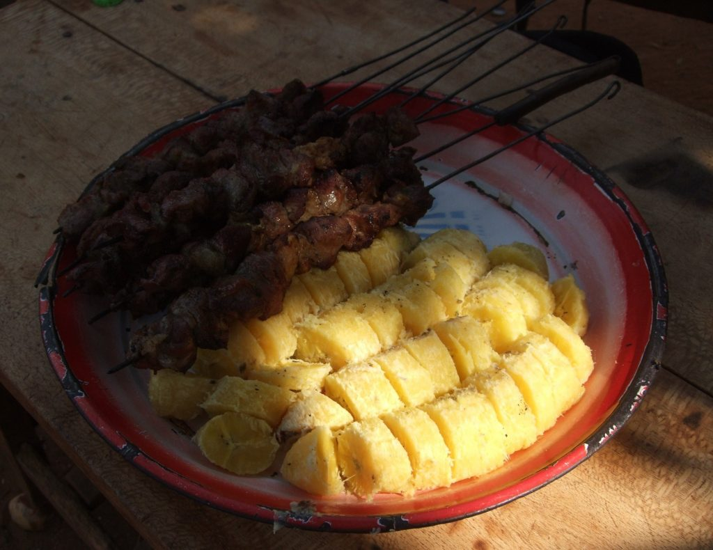 goat meat brochettes and bananas