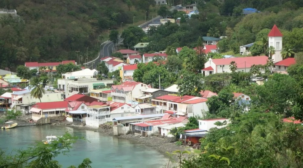 view of Deshaies seen from a hill above, as used in the starting credits of Death in Paradise