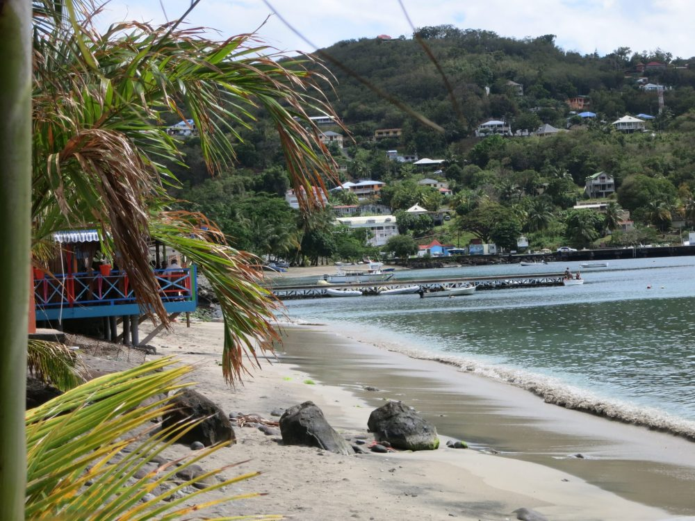 a view down the beach, taken from the restaurant used in the filming of Death in Paradise