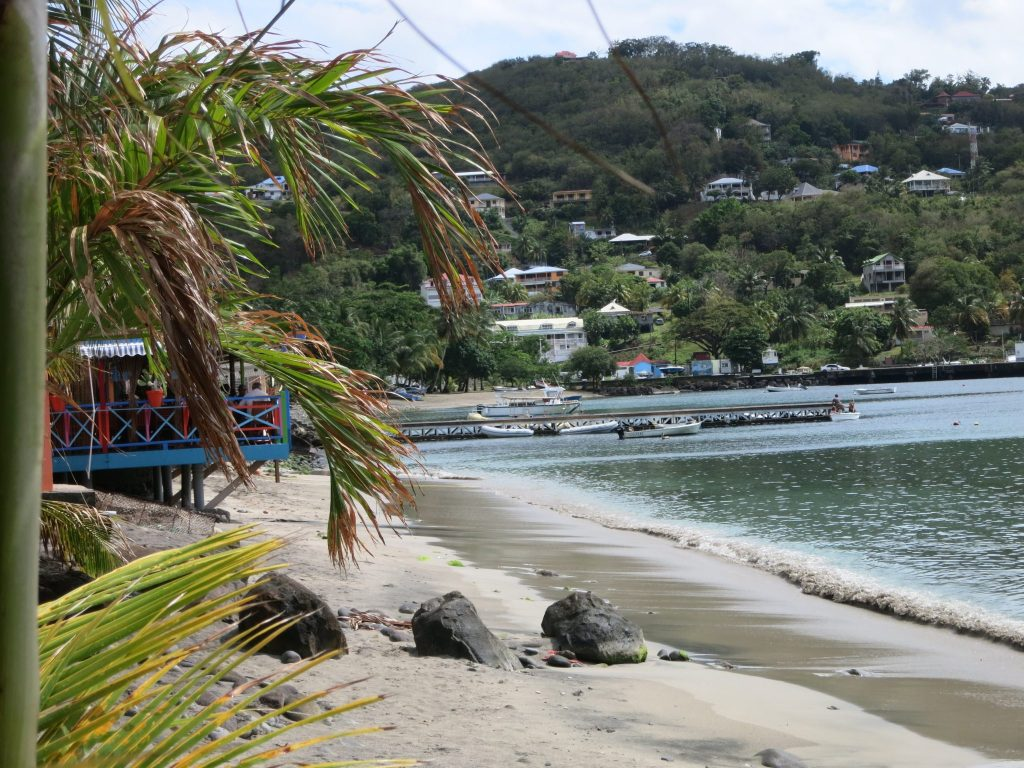 """a view down the beach, taking from the restaurant used in the filming of """"Death in Paradise"""""""