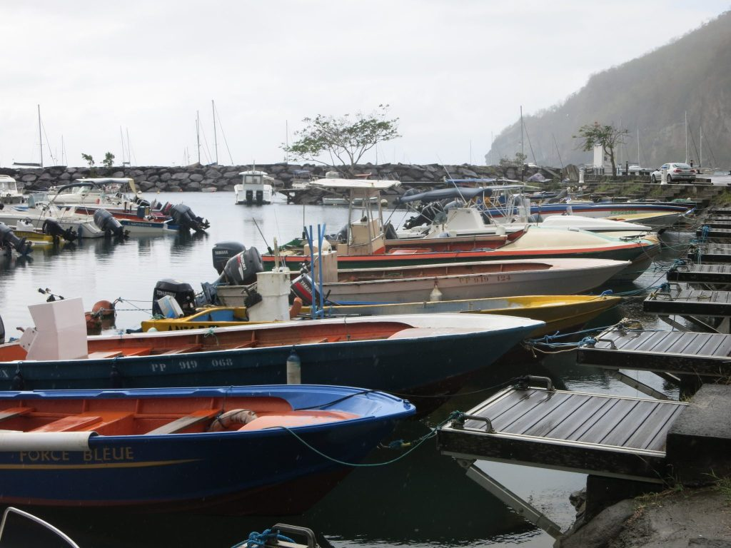 """fishing boats moored in Deshaies, where """"Death in Paradise"""" is filmed"""