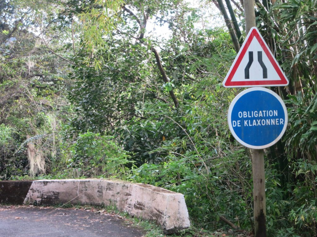 the sign saying that drivers are obliged to honk, on the way to the coffee plantation La Griviliere in Guadeloupe.