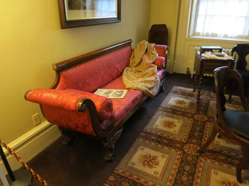 view of a period sofa in the sitting room of Merchant's House Museum