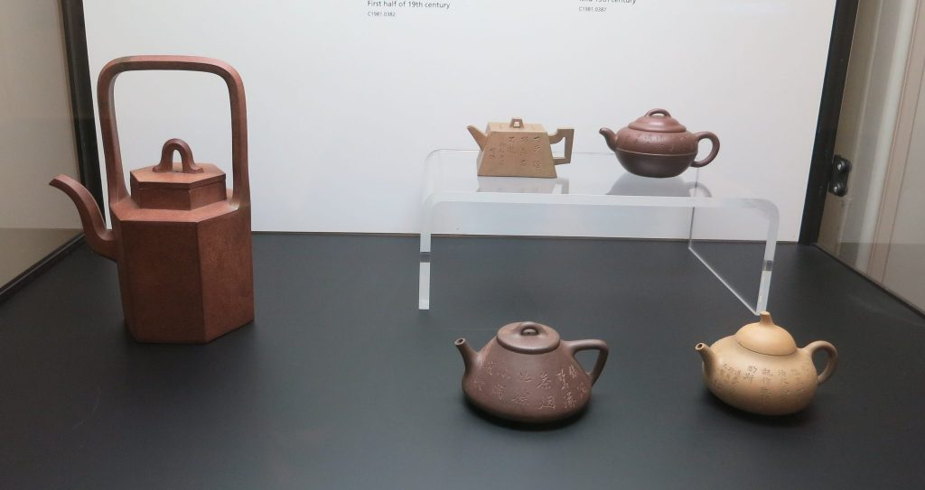 a display case with 5 teapots, in the Tea Ware Museum in Hong Kong Park
