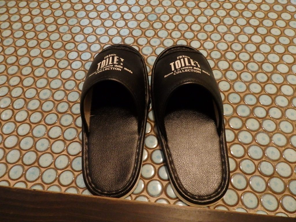 toilet slippers, in this case helpfully labeled (they read
