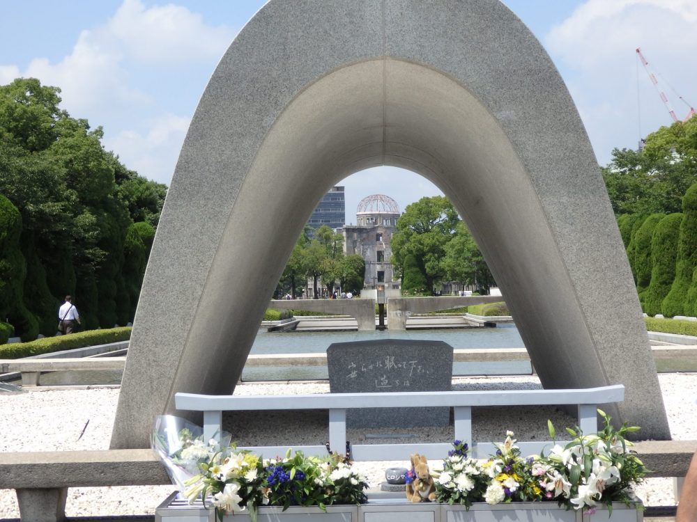the Cenotaph with the Atomic Bomb Dome in the background in Hiroshima