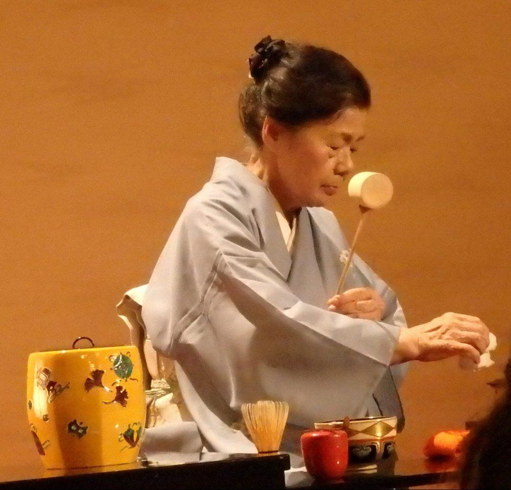 woman in a kimono performs the tea ceremony, in Gion Corner