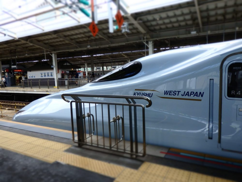 the front of the bullet train on Japan Rail from Osaka to Hiroshima: white train with a pointy front.