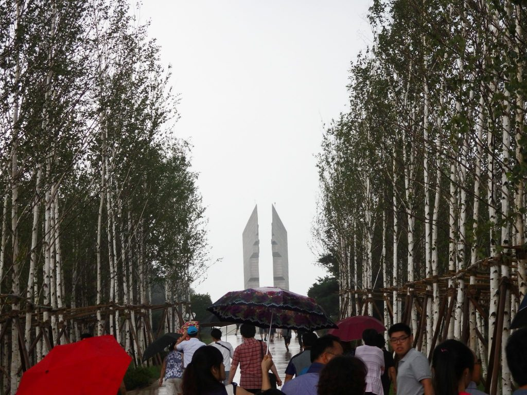 The Baengma Battlefield Monument, seen from the distance down the line of birch trees, near the DMZ.