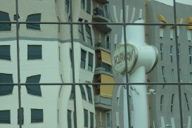 The Valor factory's sign, reflected in the factory building