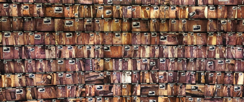 One large wall of the African Burial Ground exhibit shows a photo of each grave as it looked when it was excavated.