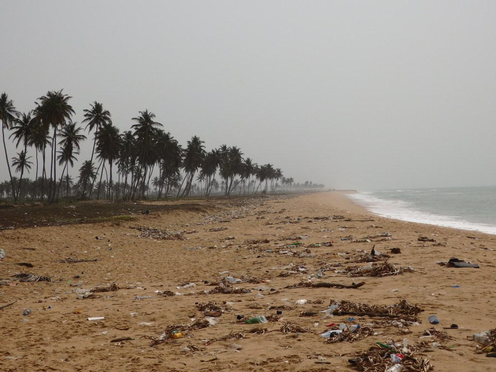 Looking south from the Point of No Return monument in Badagry, Nigeria: nothing but palm trees and trash in both directions.