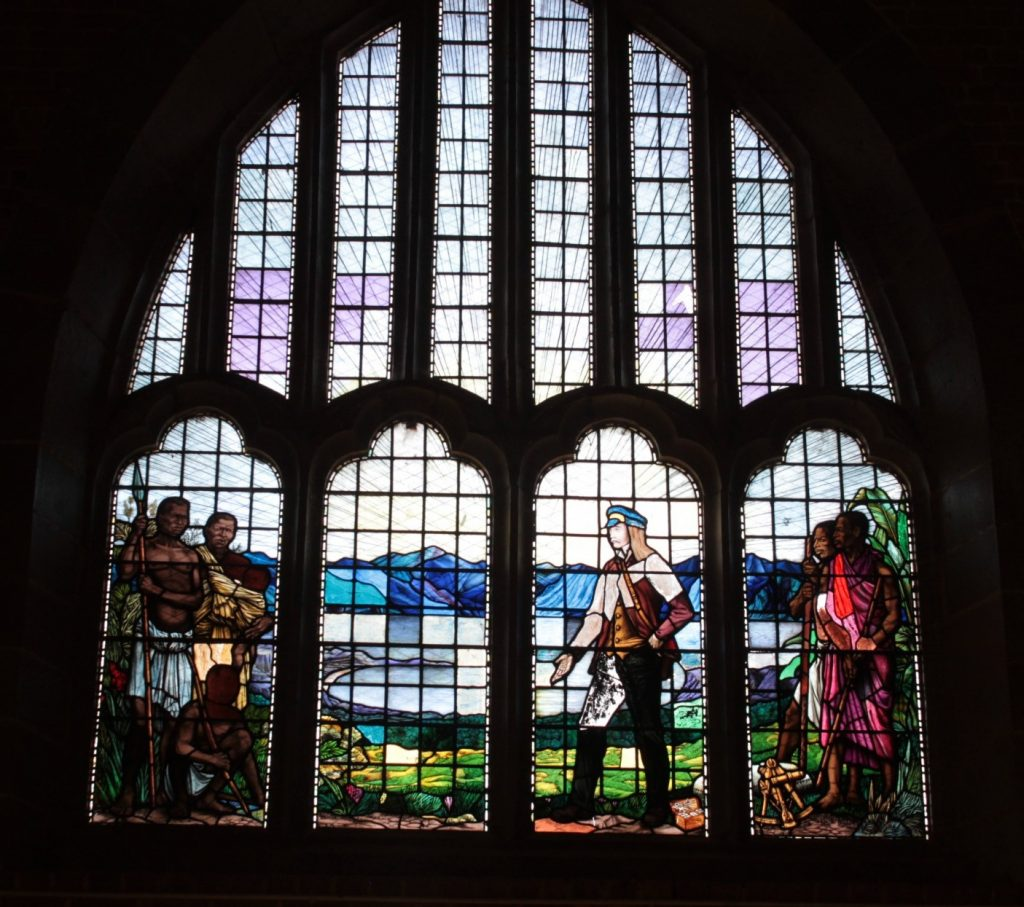 The stained glass window above the entrance to Livingstonia church: notice the colonial-era message of the white man bringing the word of God to the natives.