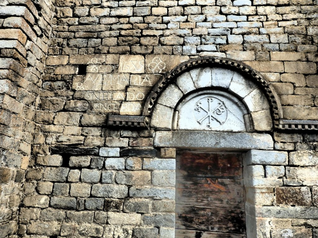 The inscription to the left of this doorway seems like it was added informally later. Santa Maria de Cap d'Aran church in Tredos, Val d'Aran, Spain