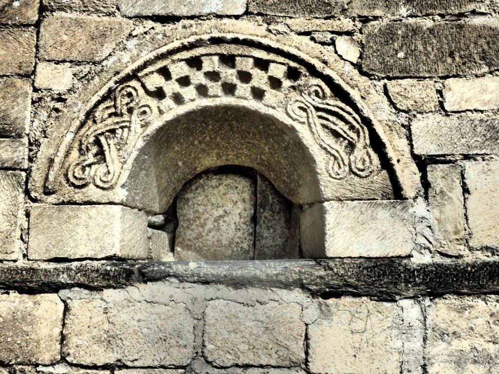 a detail carving on the church of Sant Felix in Vilac, Val d'Aran, Spain