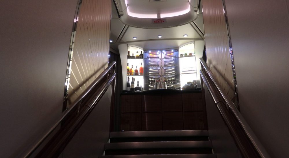 This is the closest I could get to the business and first class cabin upstairs on the Emirates A380. It's a view up the stairs, with the backlit display of liquor bottles on display at the bar.