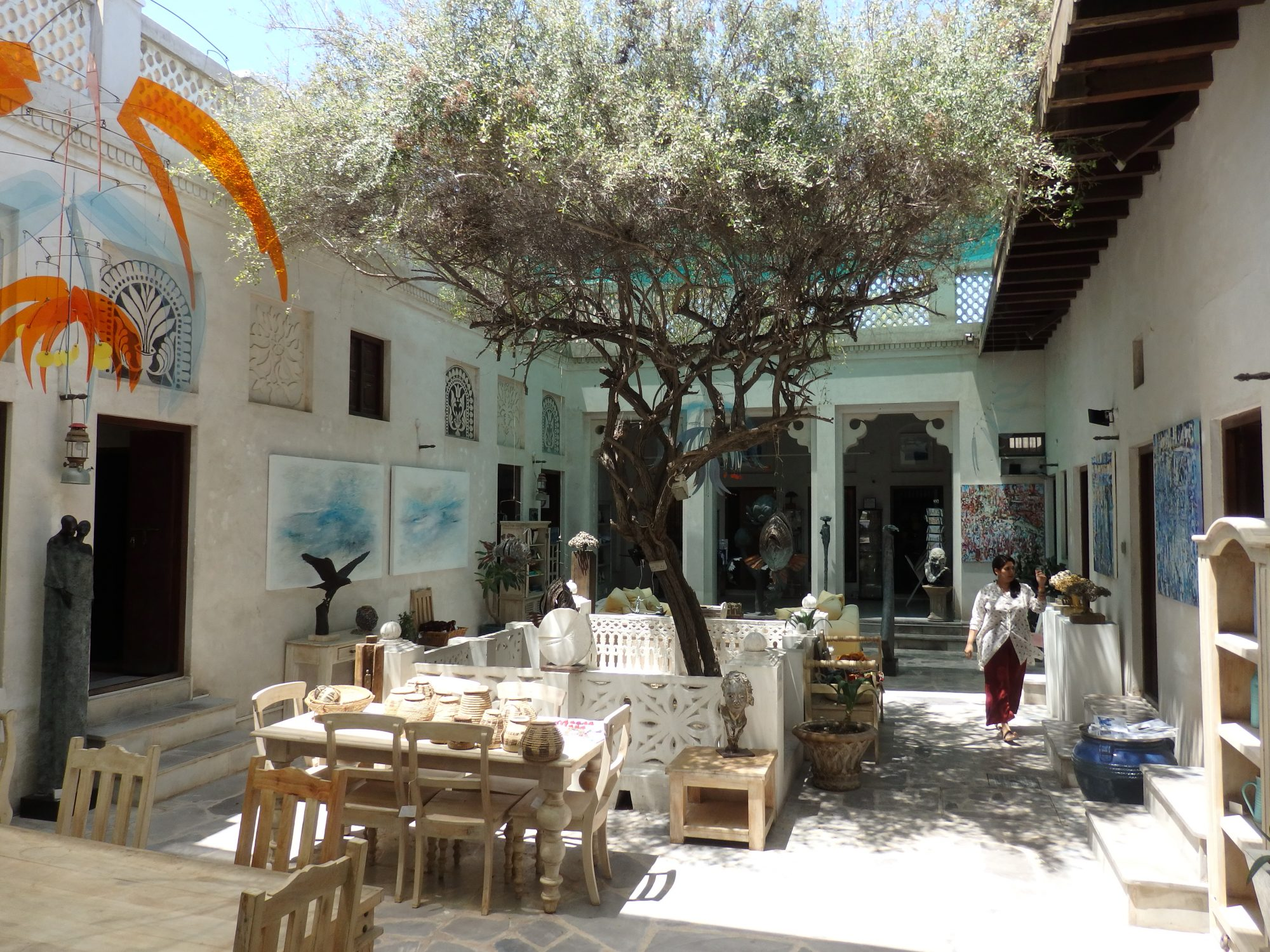 the tree-shaded, art-filled inner courtyard of the Majlis Gallery in Old Dubai